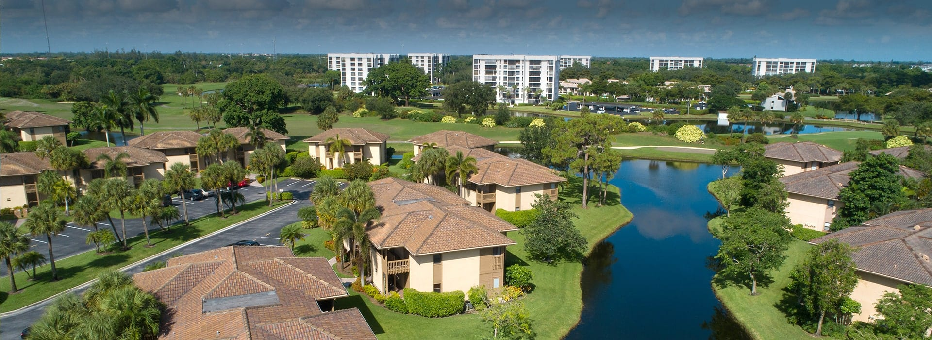 Arbor Lake townhome and villa community featuring lake and golf course views