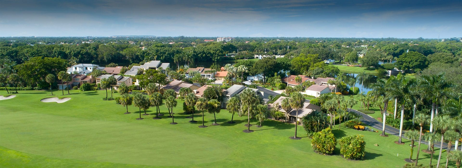 Cedarwood patio homes in Boca West with view of the golf course
