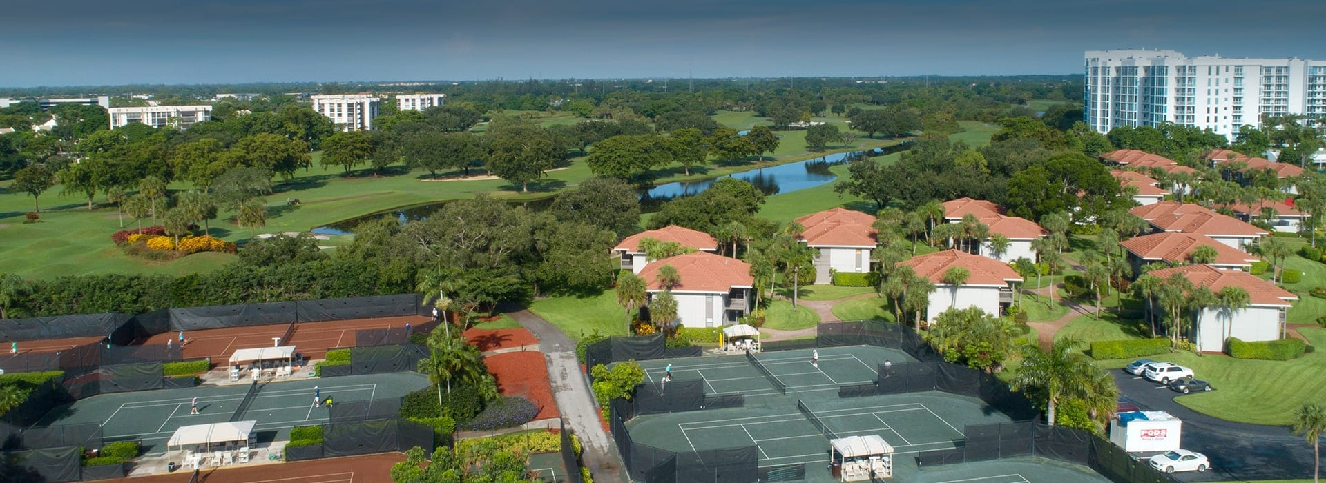 Courtside townhomes at Boca West beside the tennis courts