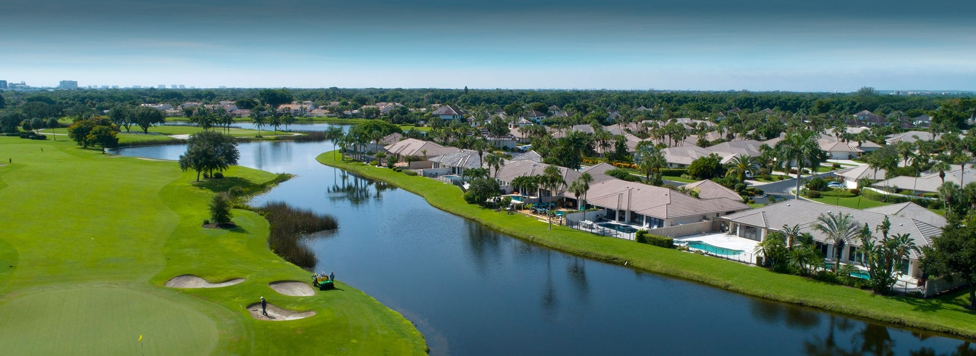 Cypress Point semi-attached and stand-alone villas at Boca West overlooking the water and golf course