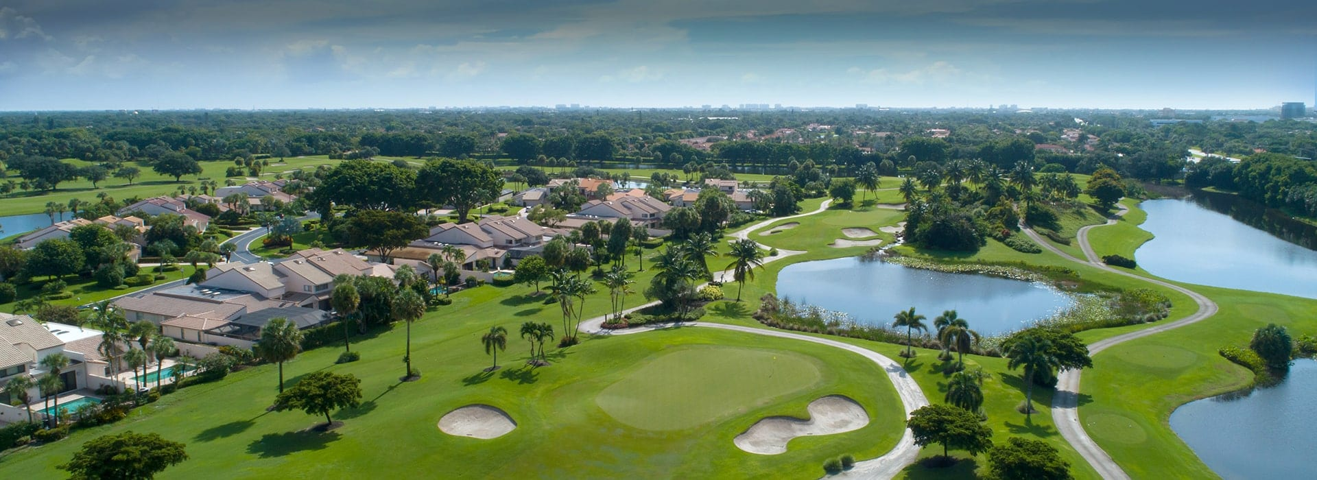 Boca West's Cypress Walk attached townhomes with golf course views