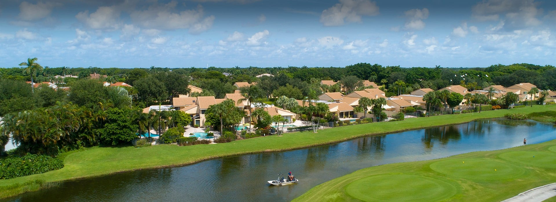 Fairway Oaks attached villas at Boca West with views of the lake and golf course