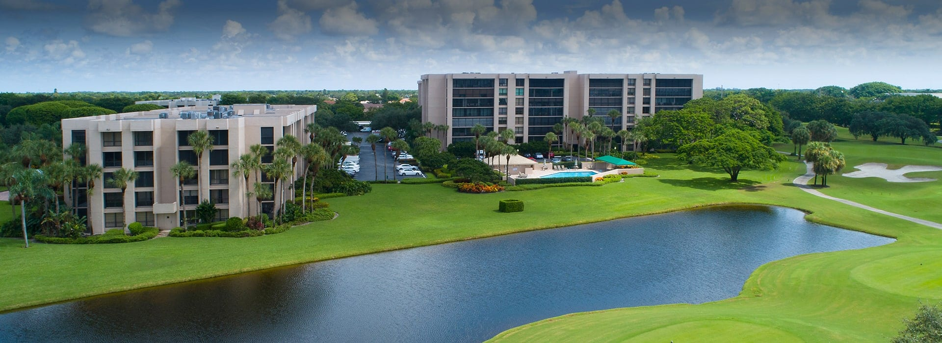 Laurel Oaks at Boca West mid-rise condominiums with water views