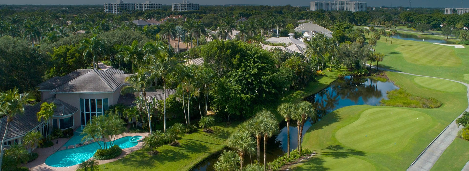 Oakbrook custom-build homes in Boca West with lush landscaping and golf course views