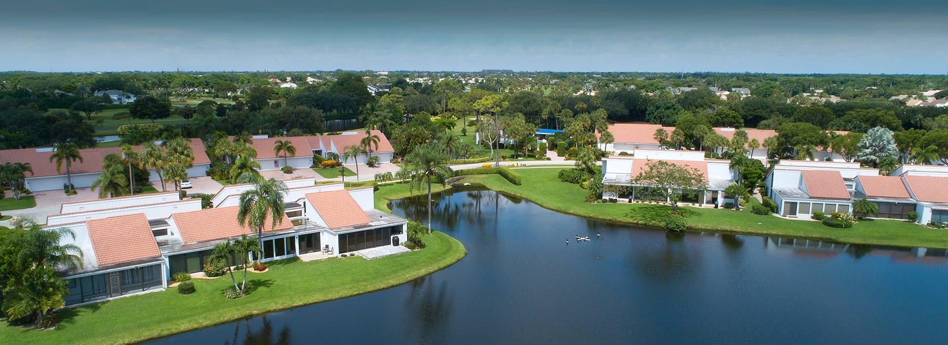 Peppertree villas of Boca West with views of water