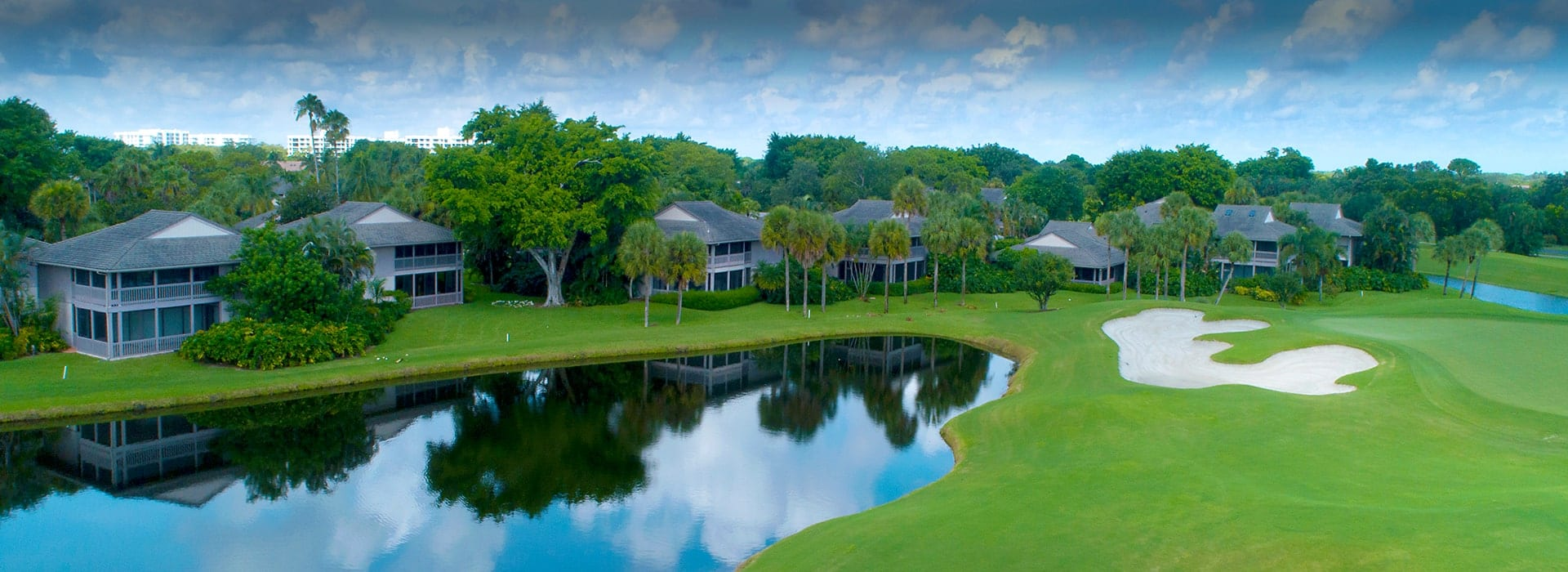 Plantation Colony attached villas nestled in among large trees and alongside the golf course