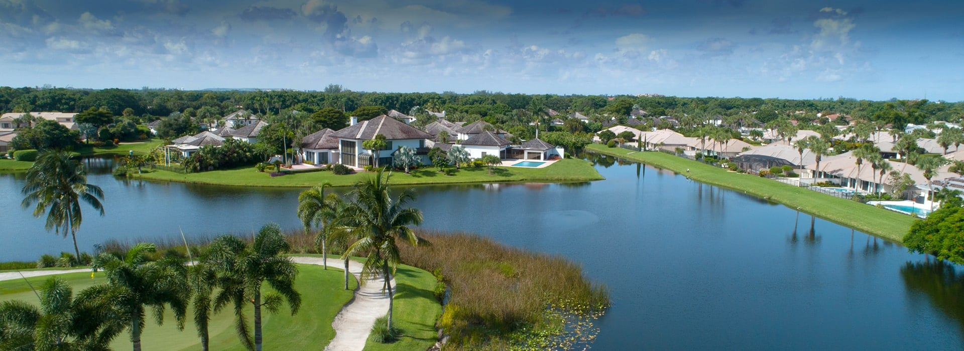 Boca West one or two-story single family homes in The Pointe along golf fairway