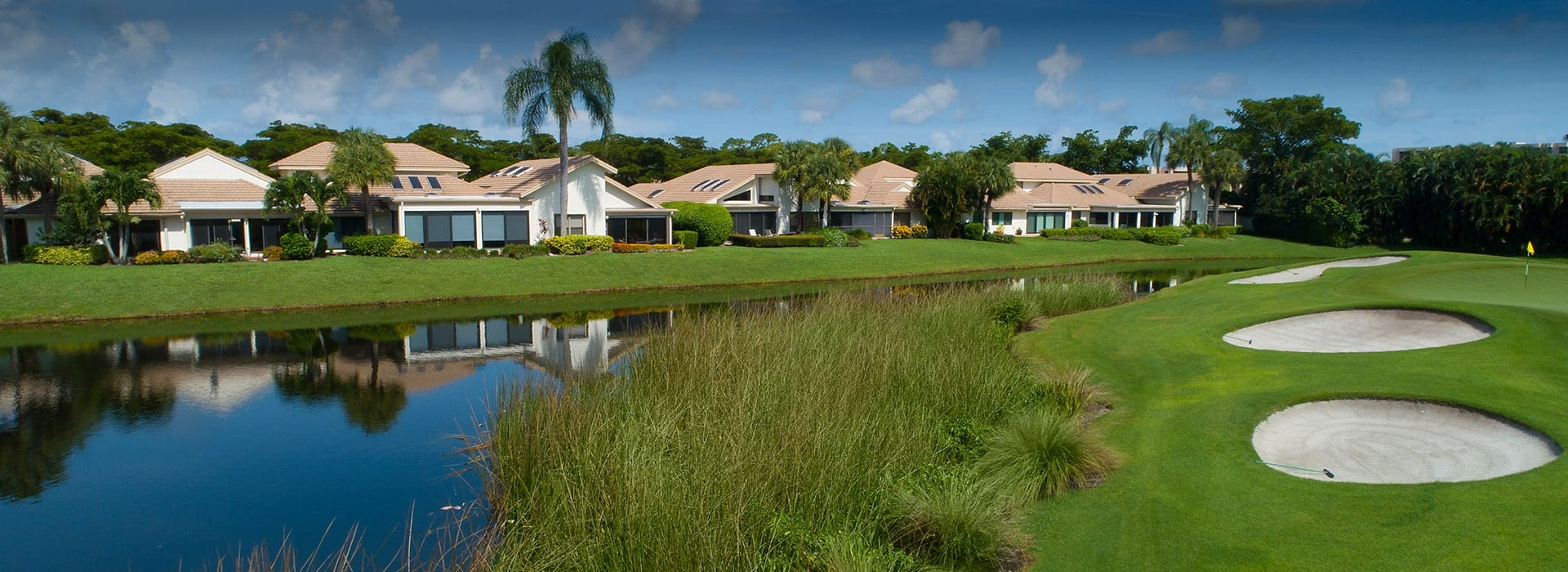 Boca West Waters Edge villa neighborhood with golf course views