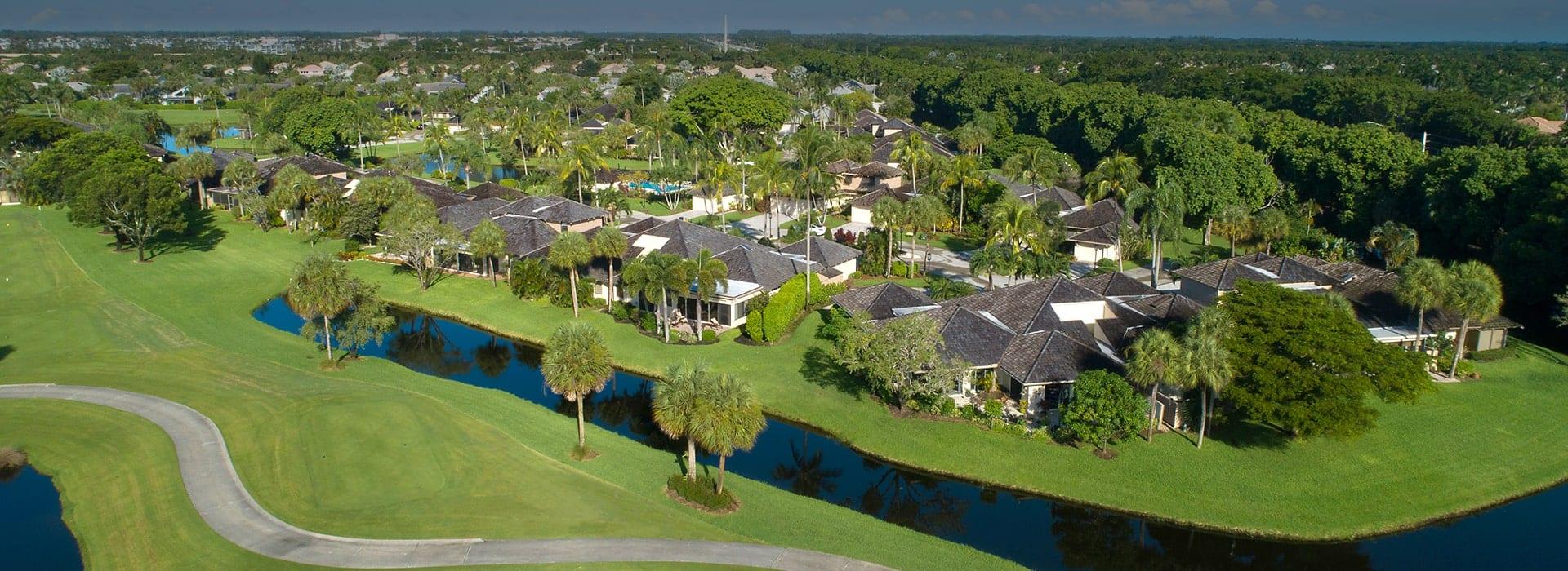 Boca West Waters Reach neighborhood alongside large lake and golf course