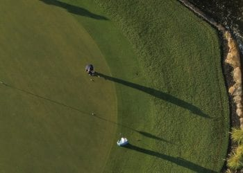 Two members play on an expansive green at Boca West