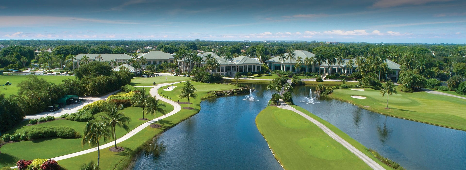 Boca West golf hole with tee boxes flanked by water on both sides