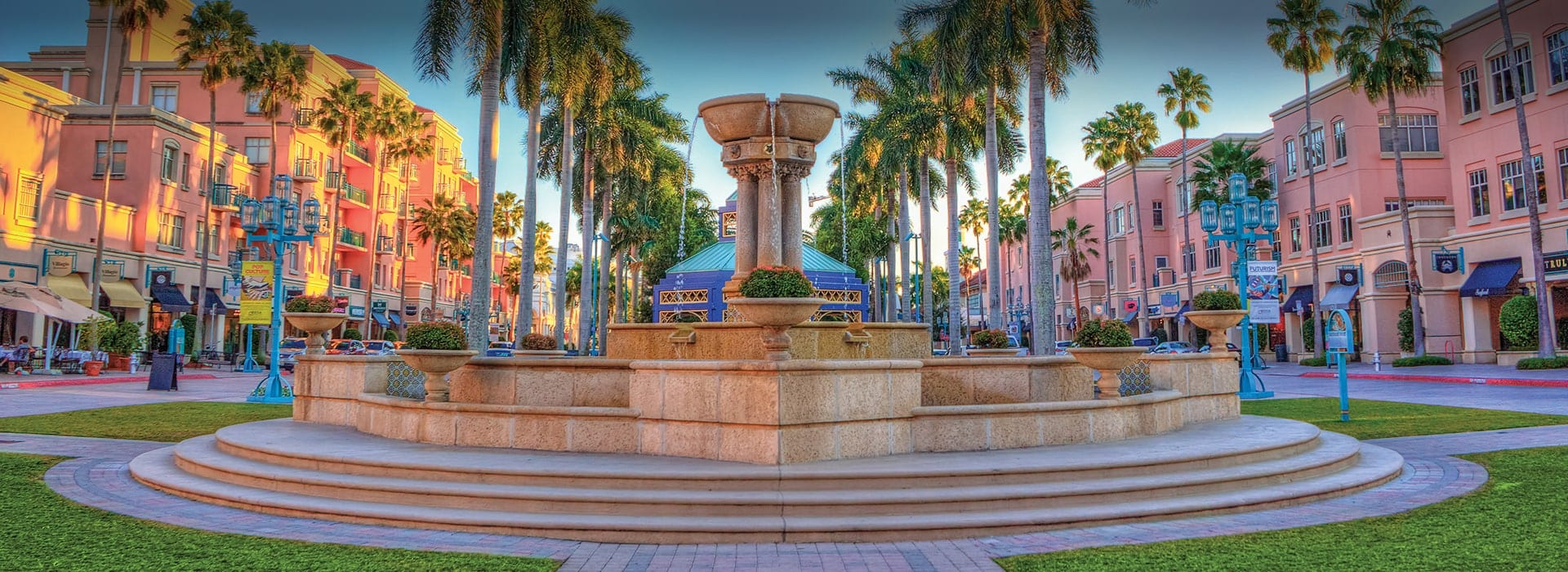 The fountain and pink buildings at Mizner Park Boca Raton