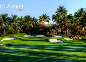Boca West Golf Course with Palm trees and blue skies