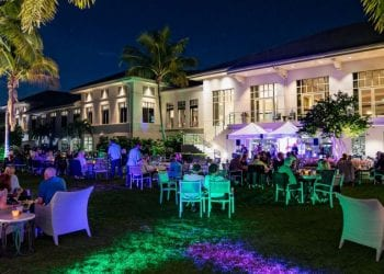 night event on lawn at boca west with tables and tents